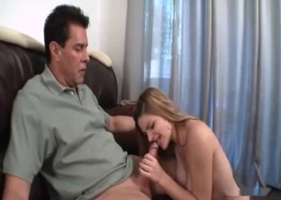 Daughter caresses father's big cock
