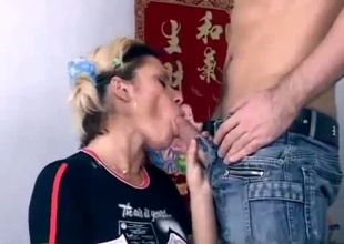 Cute Asian sucks a solid-hard cock