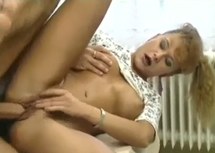 Tanned and sexy MILF banged on a table