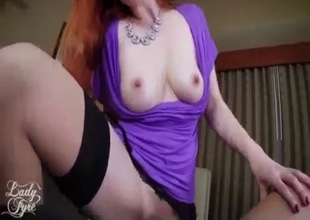 Mommy  with red hair rides in lingerie