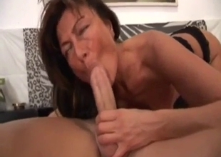 Tanned slender MILF pleases her son