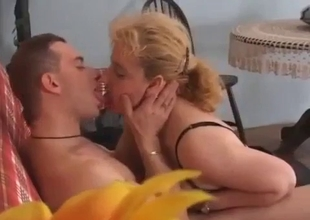 Clothed mature fucks her son