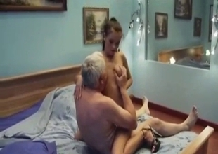 Petite lady with huge tits bounces on Grandpa
