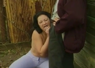 Brunette squats and sucks a small cock
