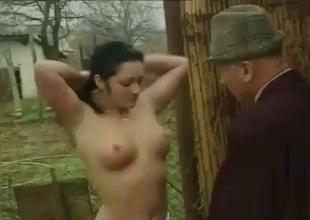 Brunette squats and sucks a small cock